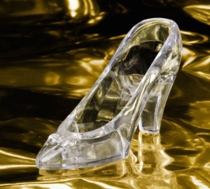 Cinderella's magical glass slipper floating on a golden sea.